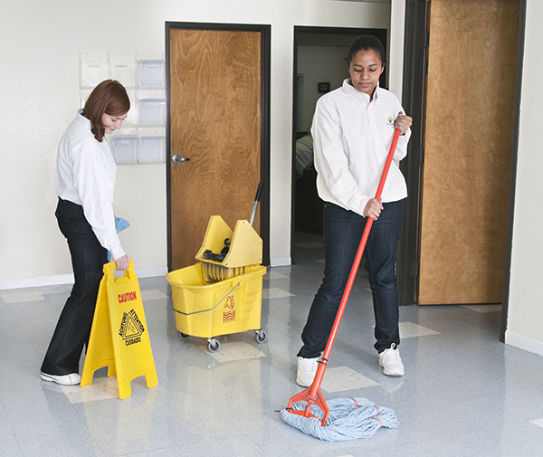 Women Cleaning Office Floor - Janitorial Services